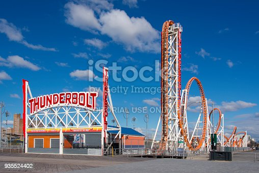 Entrance to the Thunderbolt attraction at Coney Island. A rollercoaster along the boardwalk of this historic luna park. Image taken from the public domain (the boardwalk).