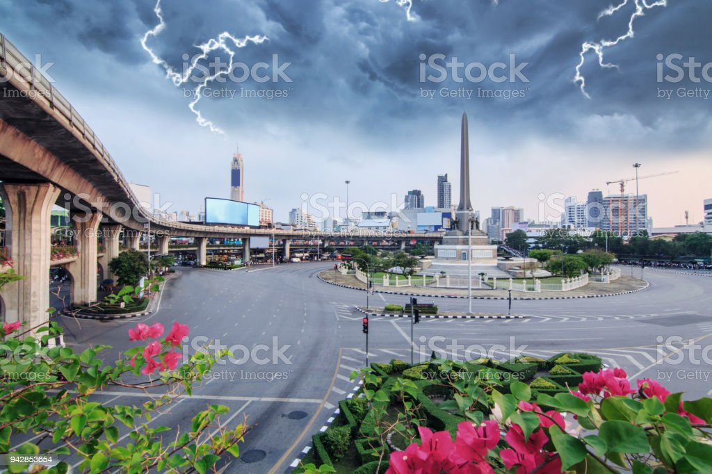thunderclap with black cloud at victory monument landmark stock photo