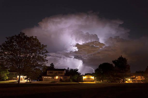Thunderhead lightning strikes over Denver homes Colorado stock photo