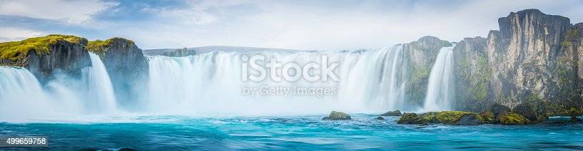 istock Thundering waterfalls cascading into blue mountain river panorama Godafoss Iceland 499659758