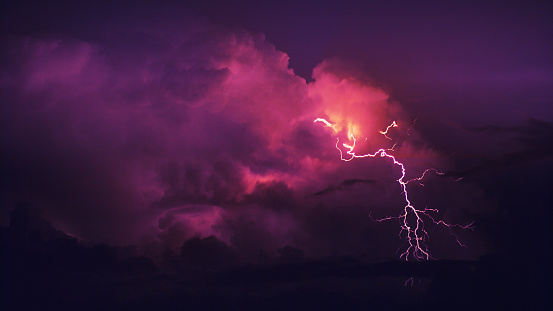 Multiple lightning strikes on a stormy evening near a city in southern Utah.  St. George, UT.