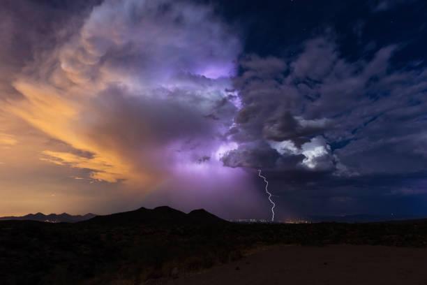 thunderstorm cloud with lightning strike - greve imagens e fotografias de stock