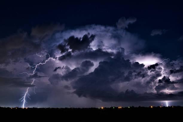 Thunderstorm illuminated by lightning stock photo