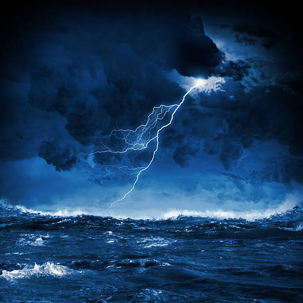 Thunderstorm in sea stock photo