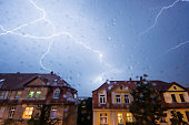 Weimar, Germany: Lightning during a thunderstorm in the city .