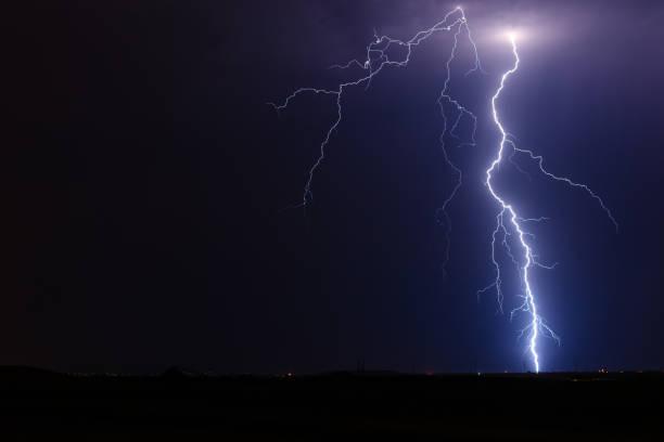 Thunderstorm lightning bolt strike stock photo
