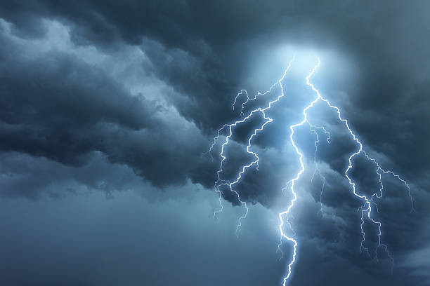 thunderstorm lightning with dark cloudy sky - dramatic sky stock photos and pictures