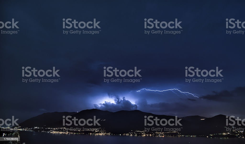 thunderstorm over mountainrange and lake Maggiore, Switzerland royalty-free stock photo