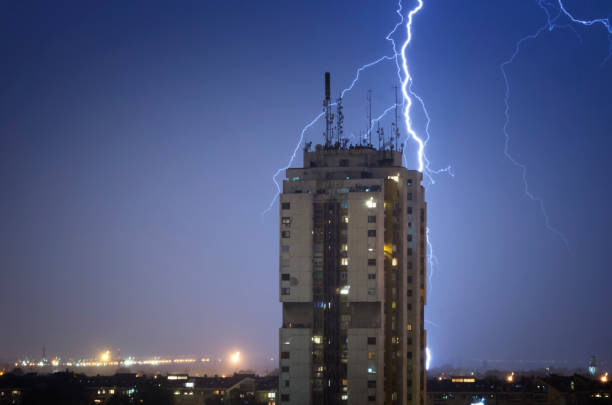 Thunderstorm over night city stock photo