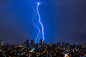 A major thunderstorm commencing at night in the city of São Paulo, in Brazil. This picture was taken in January, 2014.
