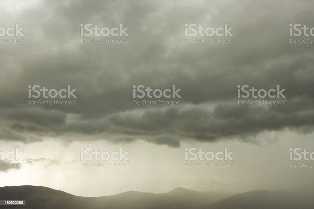 Thunderstorm rain clouds and overcast weather above high desert...