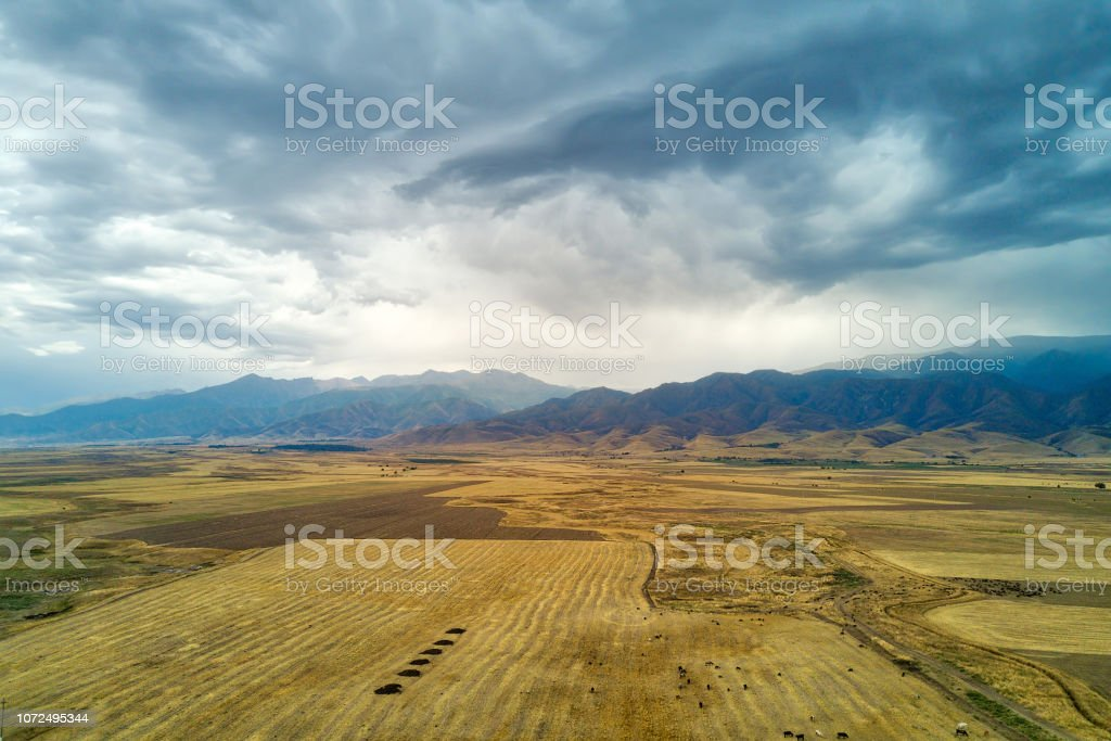 Thunderstorm View Towards Kyrgyzstan in Southern Kazakhstan taken in...