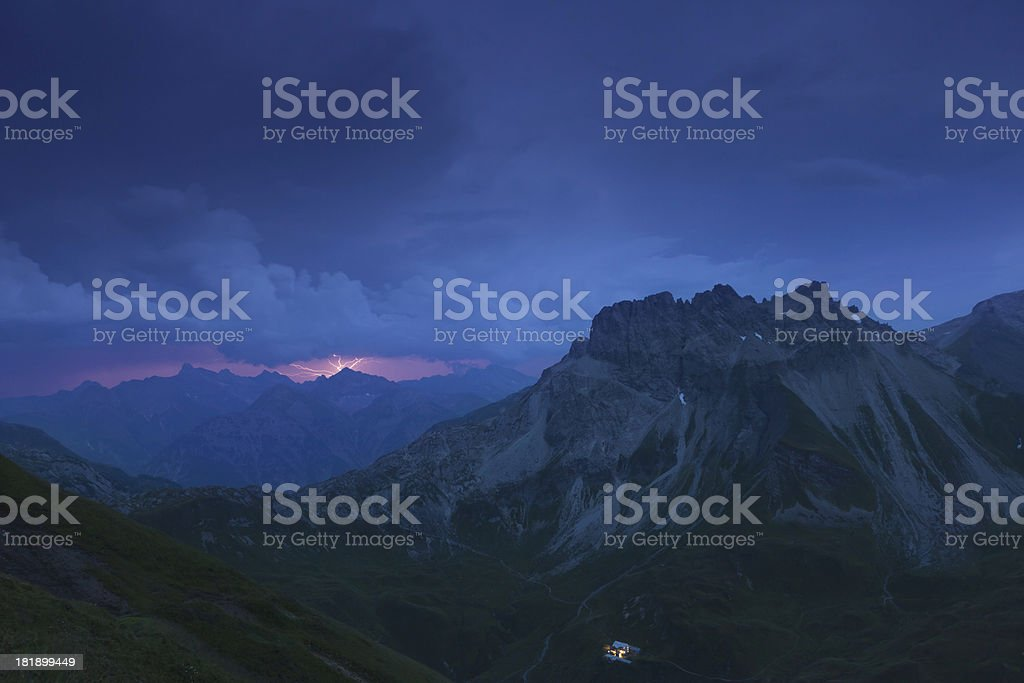 thunderstorm with lightning above the lechtaler alps stock photo