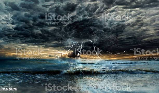Photo of Thunderstorm with lightning above the sea at sunset