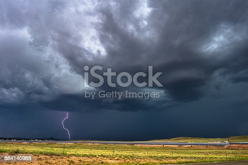 858837068istockphoto Thunderstorm with lightning and dark sky. 884140988