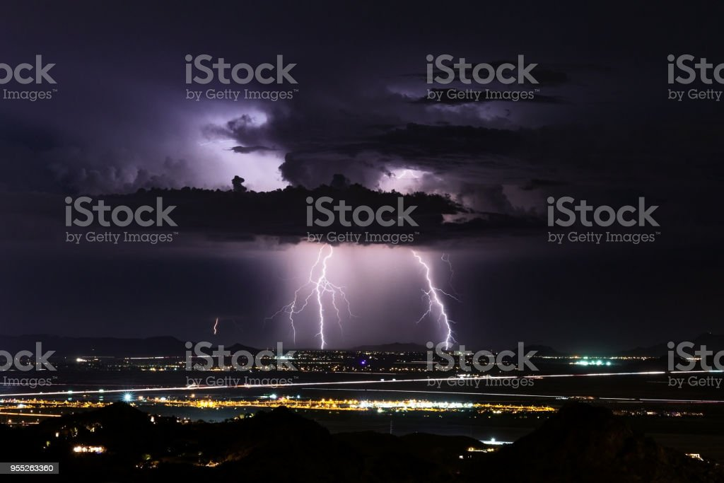 Thunderstorm with lightning bolts striking stock photo