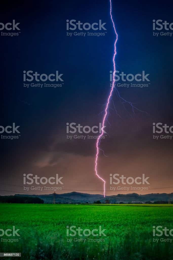 Thunderstorm with lightning in green meadow. Nature composition stock photo