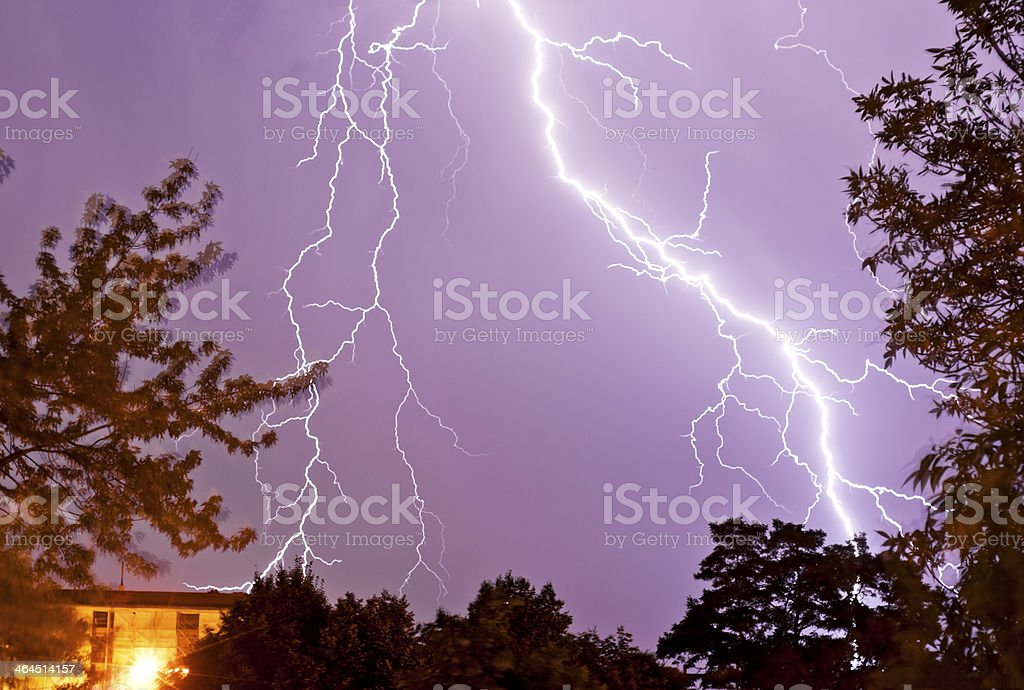 Thunderstorm with lightnings over a city stock photo