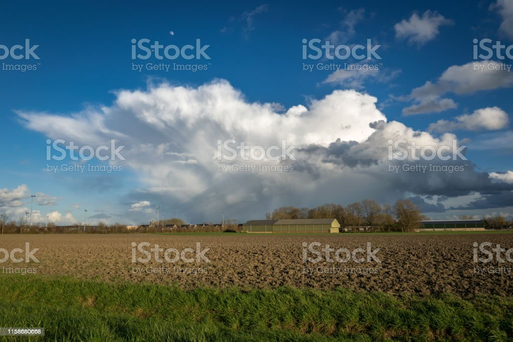 Beautiful anvil of an April shower with hail and thunder in the...