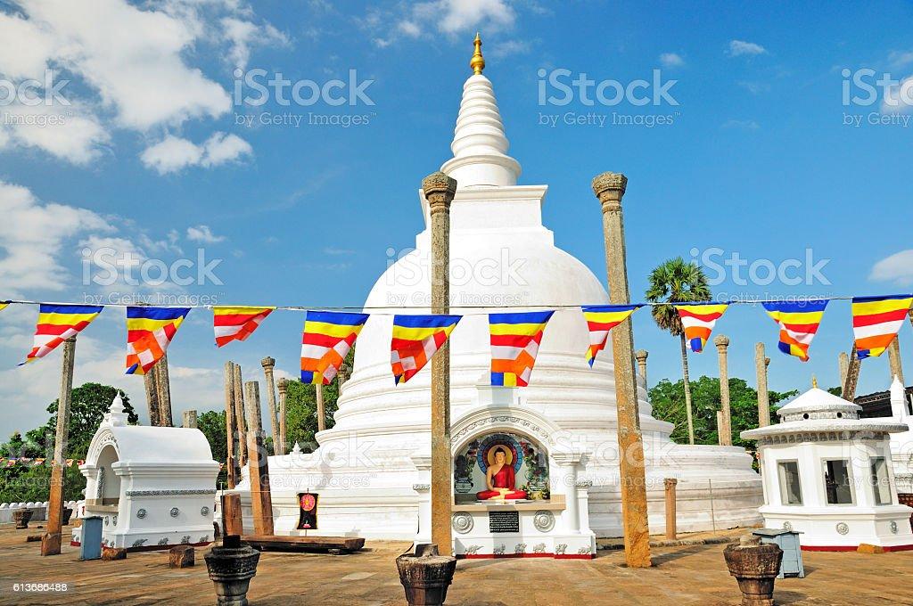 Thuparamaya Dagoba (Stupa) and Buddhist Flags, Anuradhapura, Sri Lanka - Photo