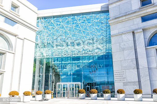 Washington DC, USA - January 13, 2018: US United States Securities and Exchange Commission SEC entrance architecture modern building sign, logo, glass windows reflection