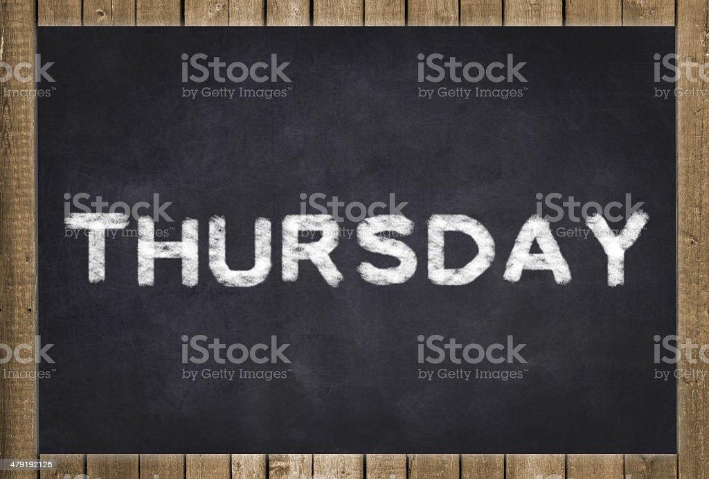 thursday - white text on chalkboard stock photo