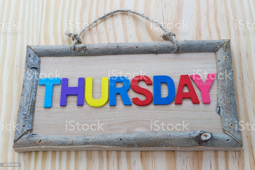 Thursday word with colorful letter on Wood Background stock photo