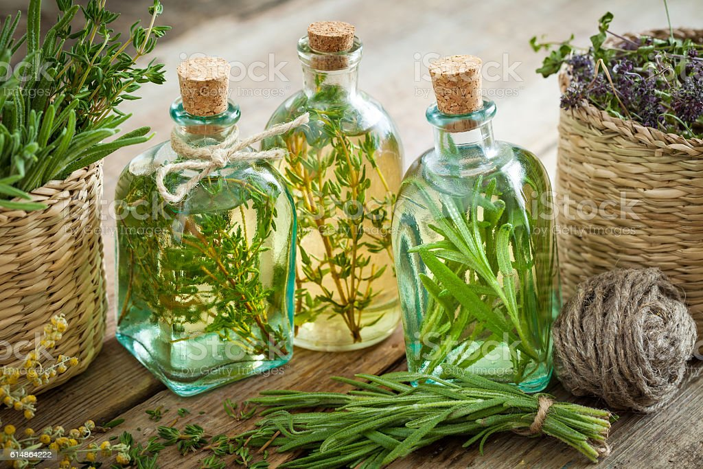 Thyme and rosemary essential oil or infusion stock photo