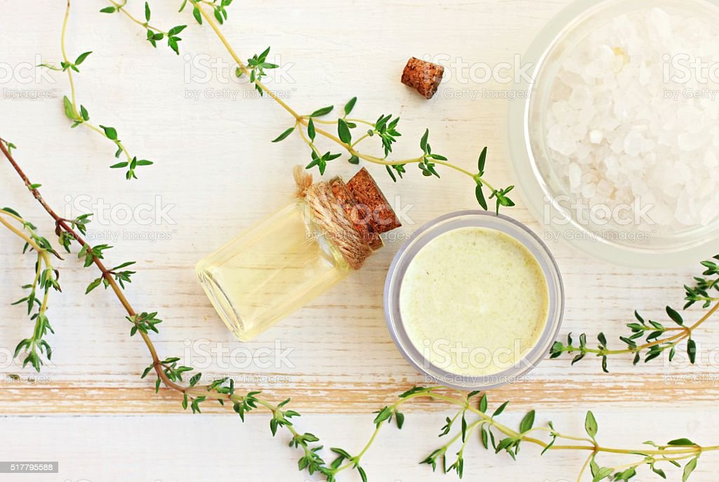 Thyme aroma oil, facial cream, sea salt. stock photo