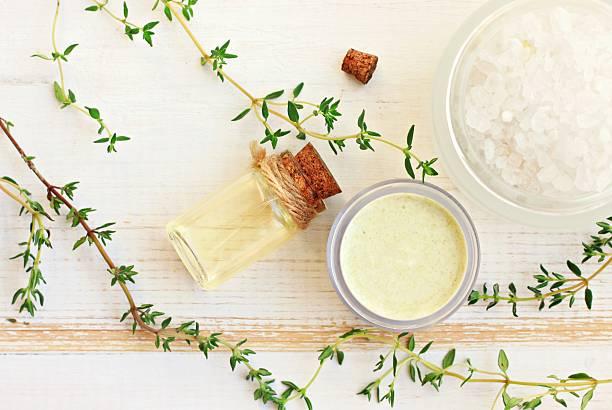 Thyme aroma oil, facial cream, sea salt. stock photo