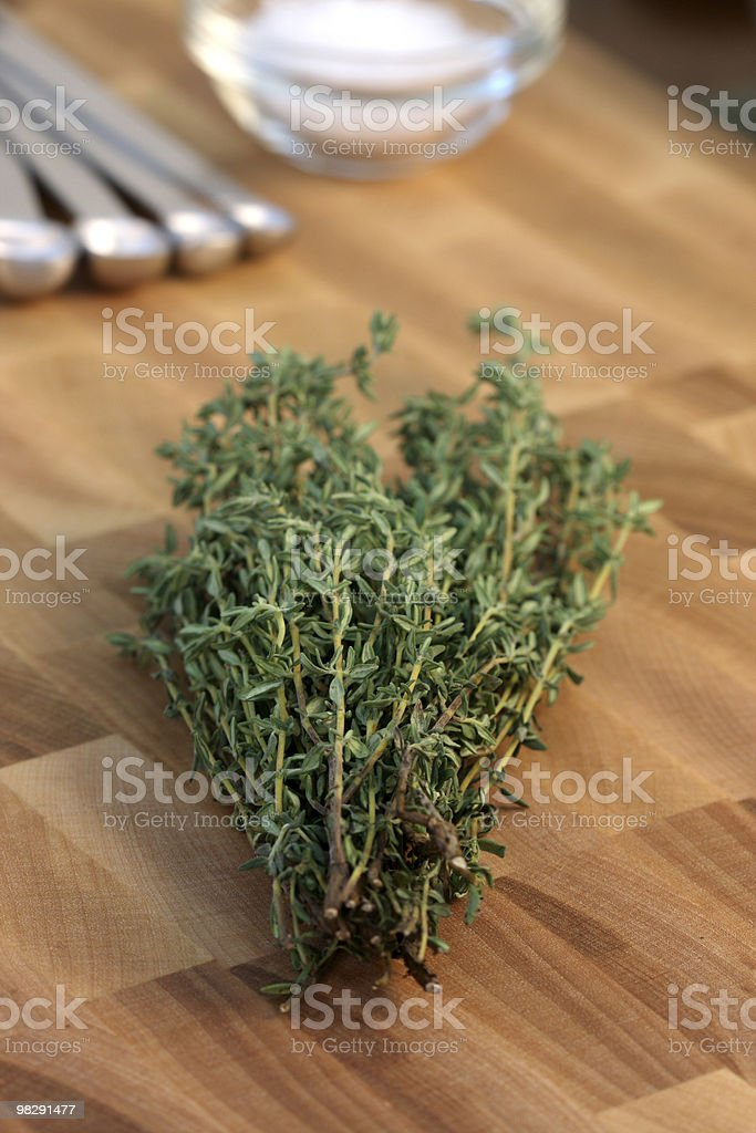 thyme on fine wood cutting board royalty-free stock photo