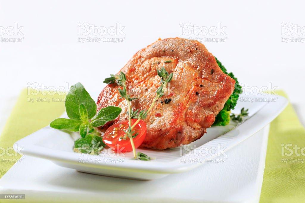 Thyme pork chop royalty-free stock photo