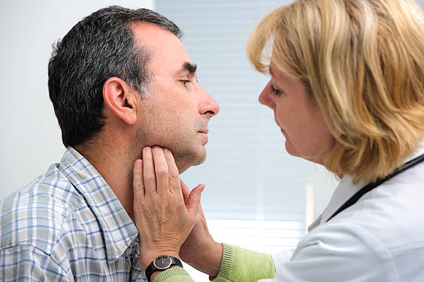 thyroid function examination stock photo