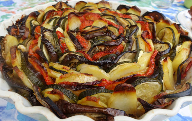 Cтоковое фото Tian of mixed vegetables with Eggplant zucchini onion tomato Provencal cuisine France
