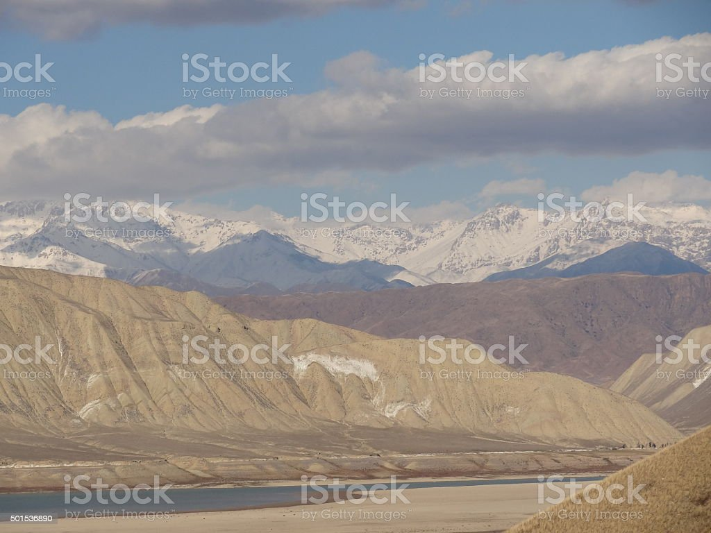 Tian Shan mountains behind Toktogul reservoir, Kyrgyzstan stock photo