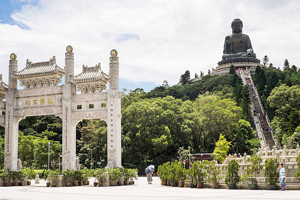 Tian Tan or Big Buddha on Lantau Island, Hong Kong Hong Kong, China - August 26, 2014: Tian Tan Buddha, also known as the Big Buddha, is a large bronze statue, completed in 1993, on Lantau Island. new territories stock pictures, royalty-free photos & images