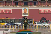 Beijing, China - December 5, 2015: Tianamen Square is a famous tourist attraction in Beijing, China. A Chinese army guard standing in the front of the Tiananmen Square,which is the south entrance of the Forbidden City.