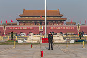Beijing, China - December 5, 2015: Tianamen Square is a famous tourist attraction in Beijing, China. A few Chinese army guard standing in the front of the Tiananmen Square,which is the south entrance of the Forbidden City.