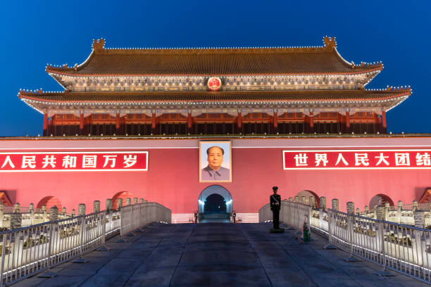 Tiananmen in Beijing at night Beijing, China - Mar 23, 2018: Tiananmen in Beijing at night, also called the Gate of Heavenly Peace. It is a monumental gate and a national symbol of China. mao tse tung stock pictures, royalty-free photos & images