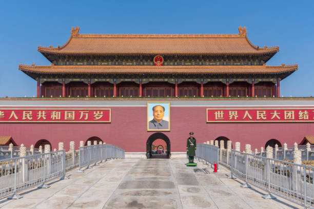 Tiananmen in Beijing Beijing, China - Mar 16, 2018: Soldier standing in front of Tiananmen in Beijing, also called the Gate of Heavenly Peace. It is a monumental gate and a national symbol of China. mao tse tung stock pictures, royalty-free photos & images