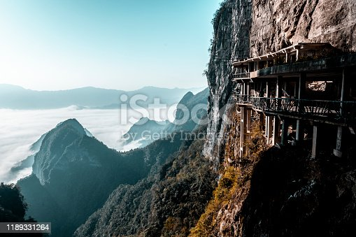 A walkway balcony in the Tianmen mountain (天门山) overlooking a wonderful fog-covered valley, Hunan Province (湖南省), China.