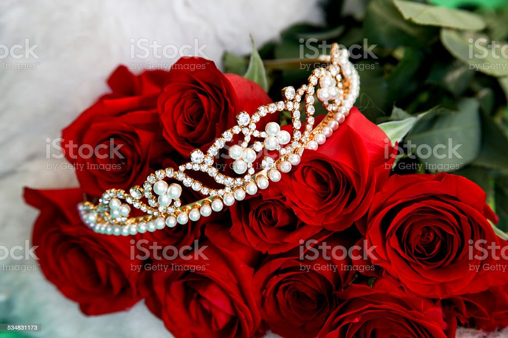 Tiara and Red Roses stock photo