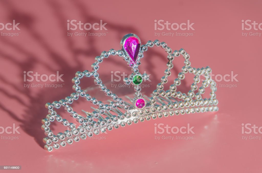 tiara with stones, toy jewelry on the table stock photo