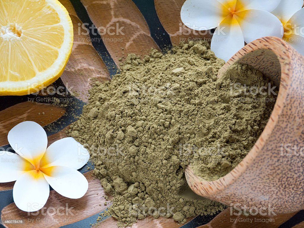 Tiare flowers, lemon and henna powder stock photo
