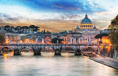 Amazing view of Rome with snow; on background the St. Peter's Basilica and Sant'Angelo bridge. Snowfalls in Rome are very rare, the last similar snowfall was in 1985.
