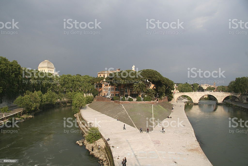 Tiber Island with blue clouds in background royalty-free stock photo