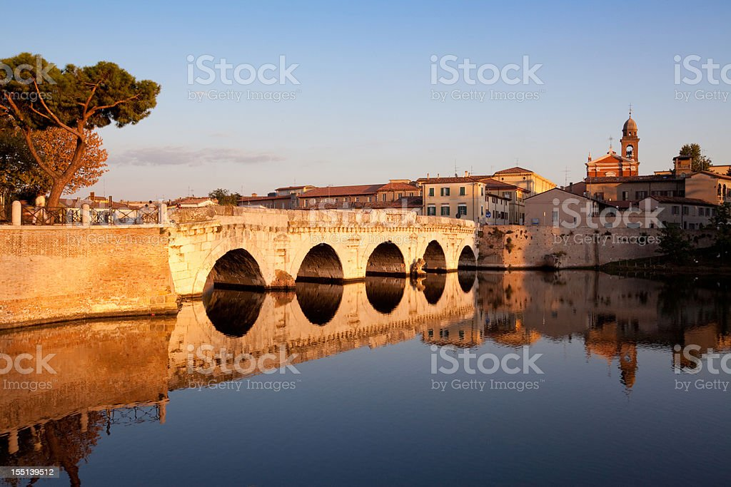 Tiberius bridge in Rimini, Italy this Italian landmark architecture was constructed by the Romans in the 1st century a.C. The five-arched bridge is still in use for the lively traffic in town. Rimini Stock Photo