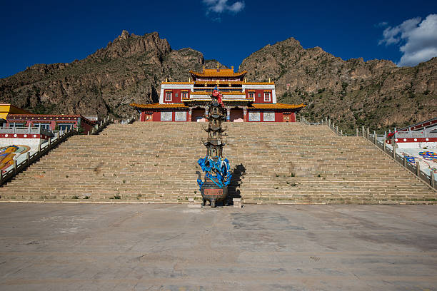 Tibet temple with mountain and square stock photo