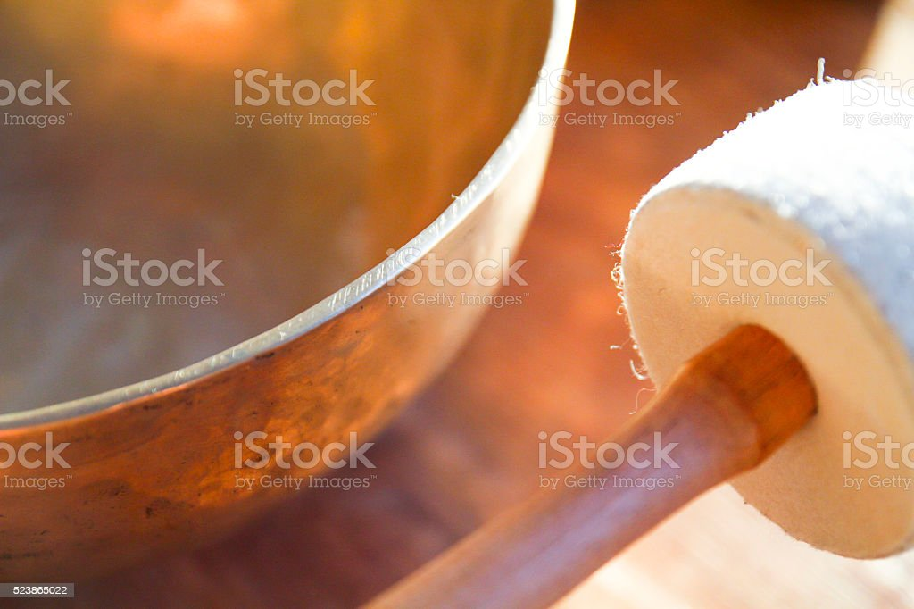 Tibetan bell and drumstick closely stock photo