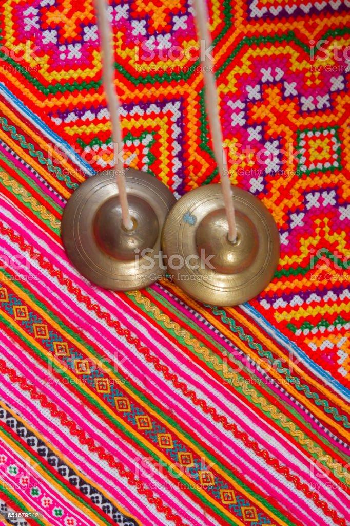 tibetan bell tingsha on color fabric . stock photo